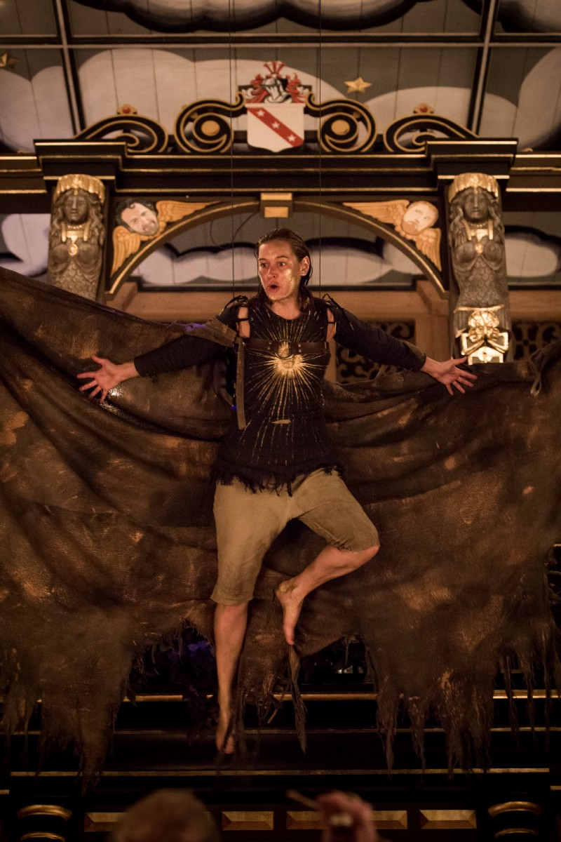 A woman with ragged wings flying in the Sam Wanamaker Playhouse