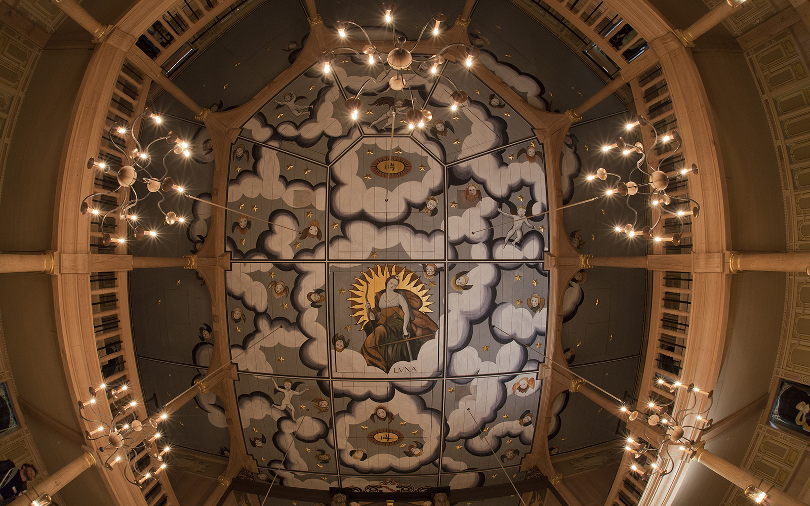 An intricately painted ceiling, looking up at it from below
