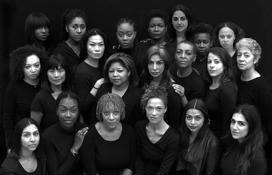 A black and white image of many women of colour grouped together