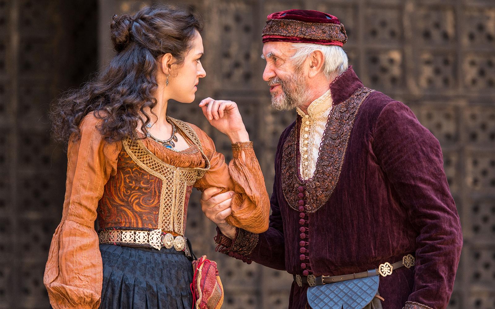 Shylock grabbing Jessica's arm in The Merchant of Venice