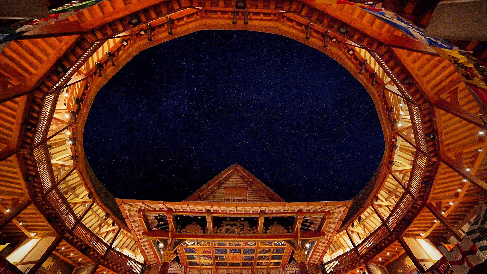 Dark starry sky shown through the roof of the Globe