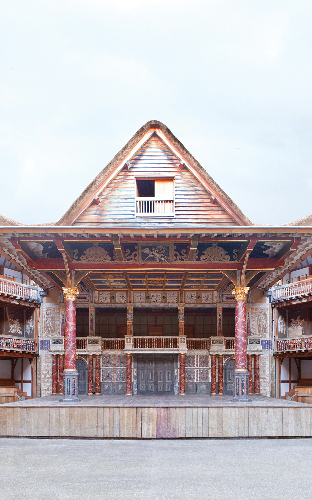The front of the Globe Theatre with its pointed roof over the stage