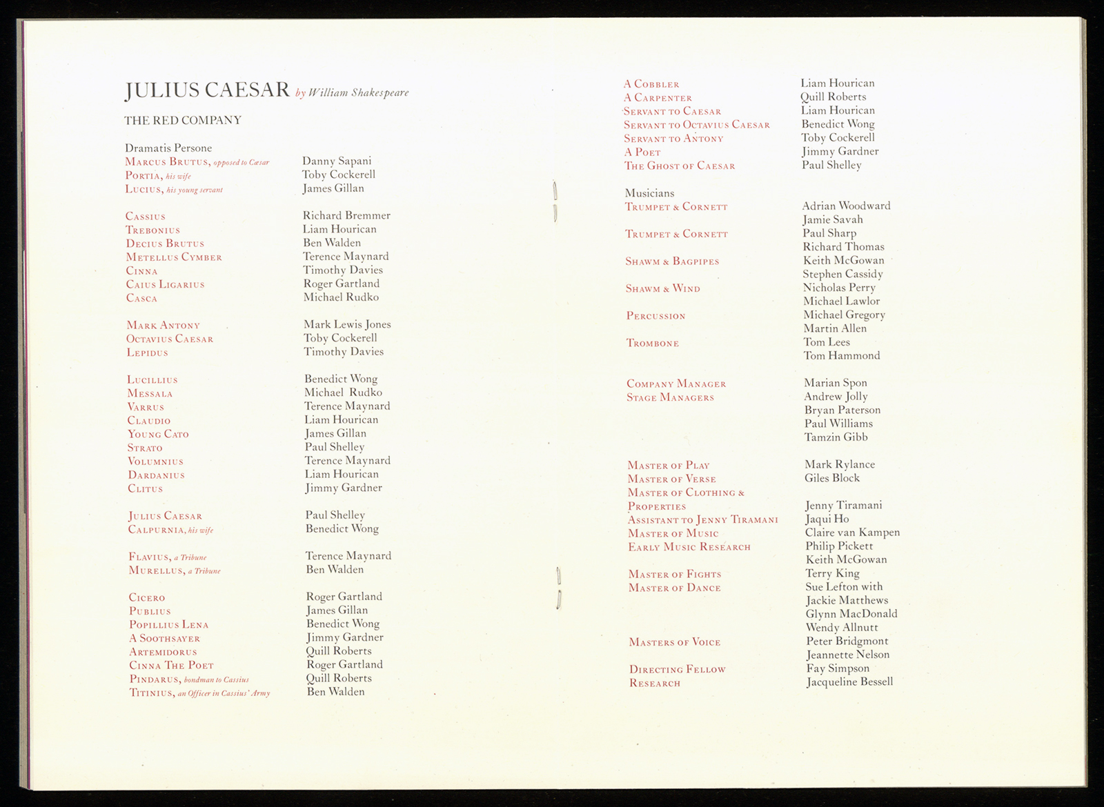 A programme listing the names of the cast and creative team.