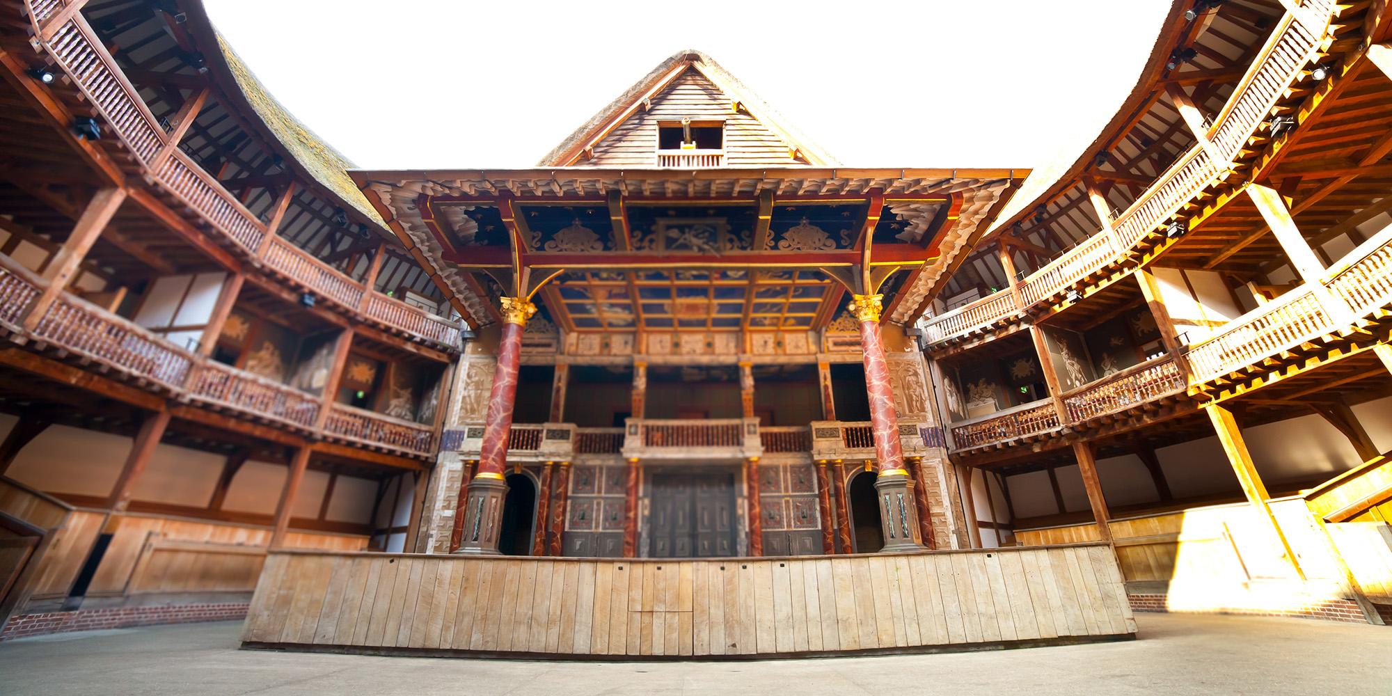 Interior shot of a wooden circular theatre, looking upwards.
