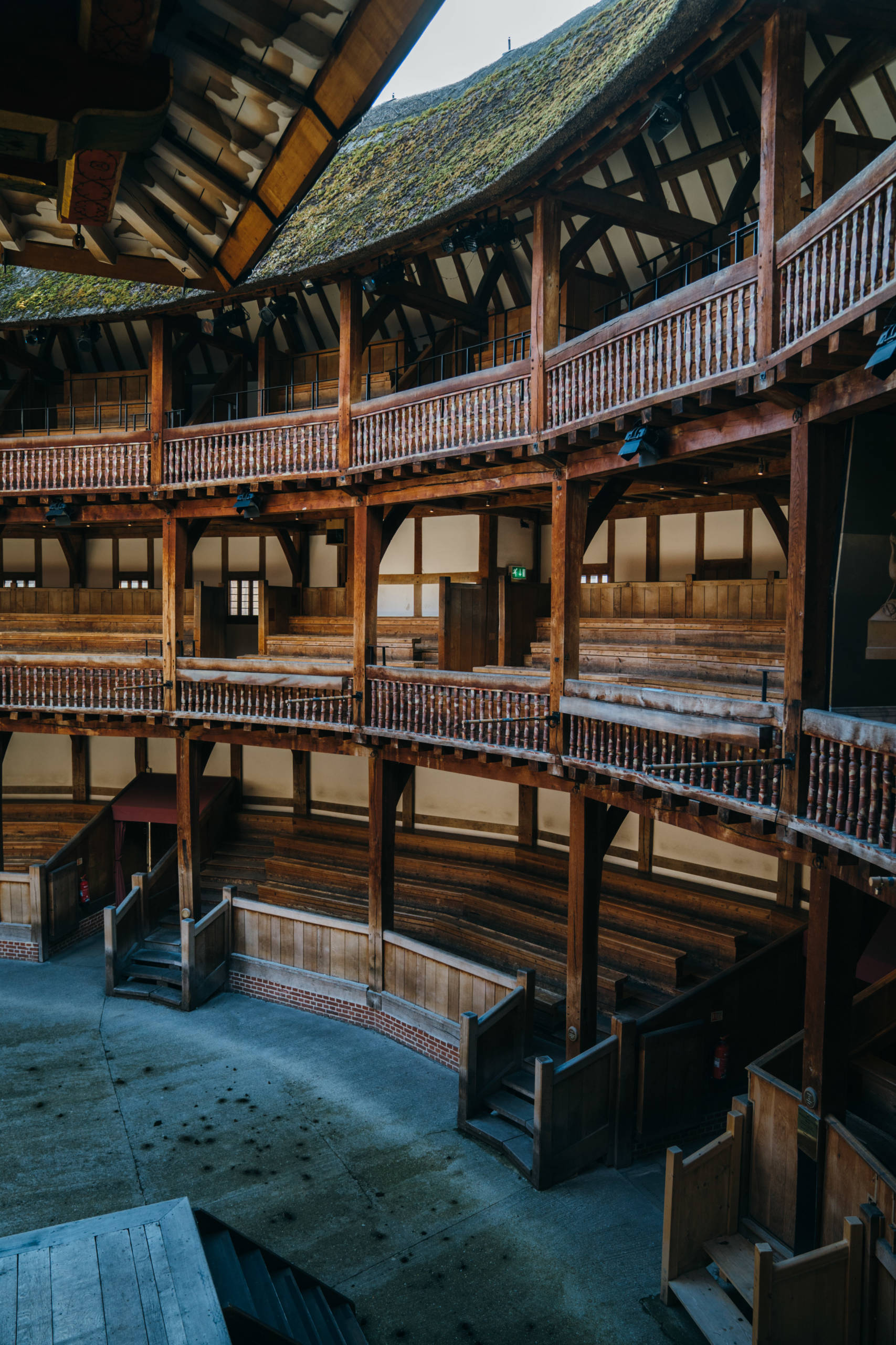 The view from the balcony of a theatre looks out to an empty seating area