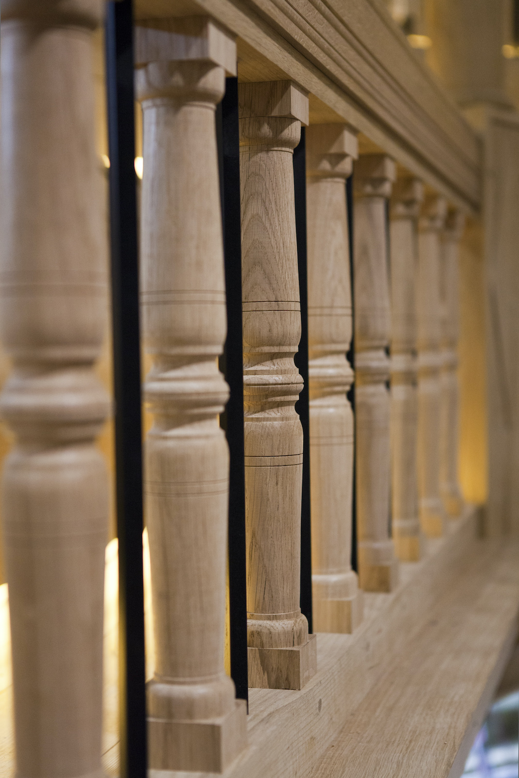 A close up of the wooden bars that line a gallery of a stage