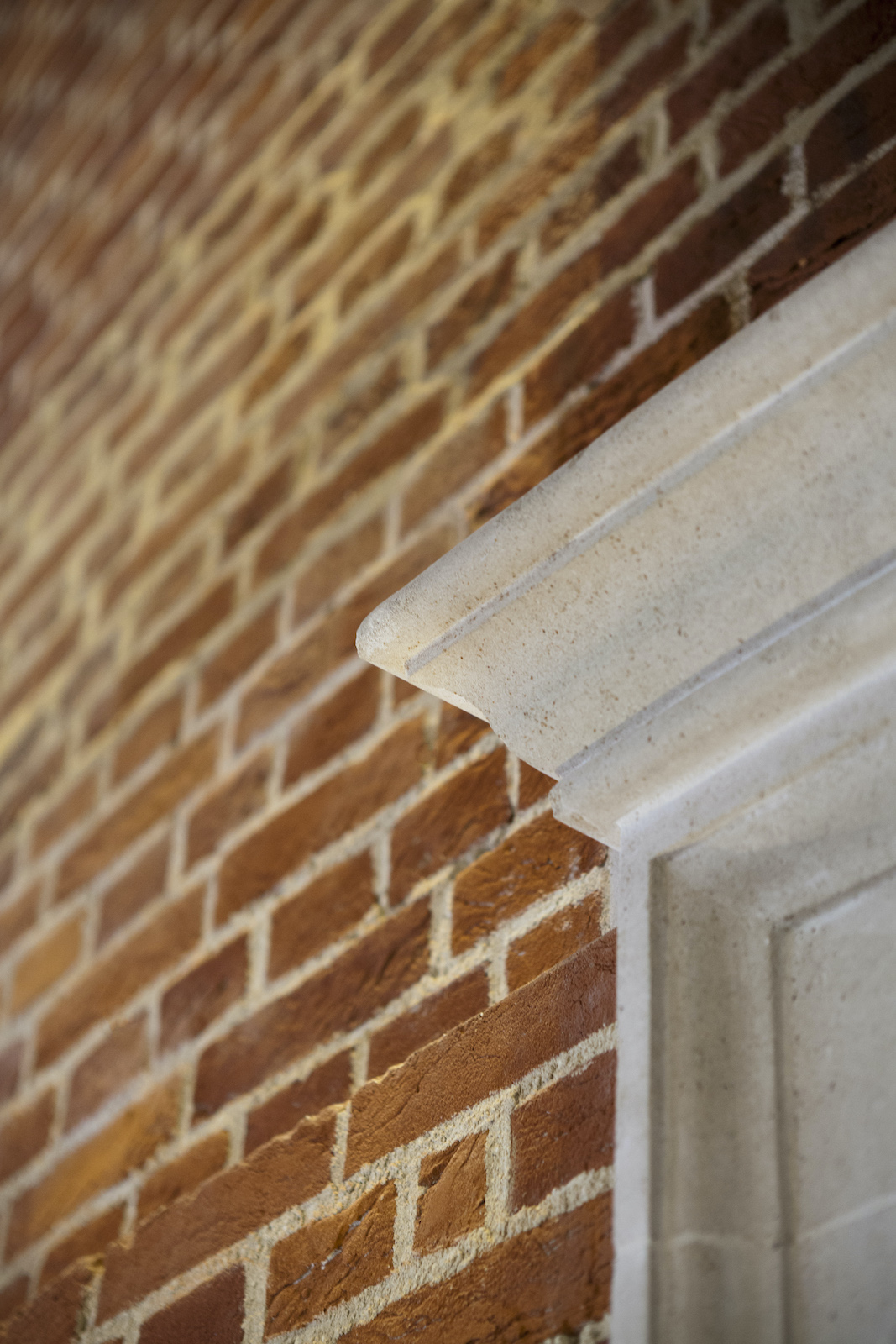 Details of a white door frame against a brick building