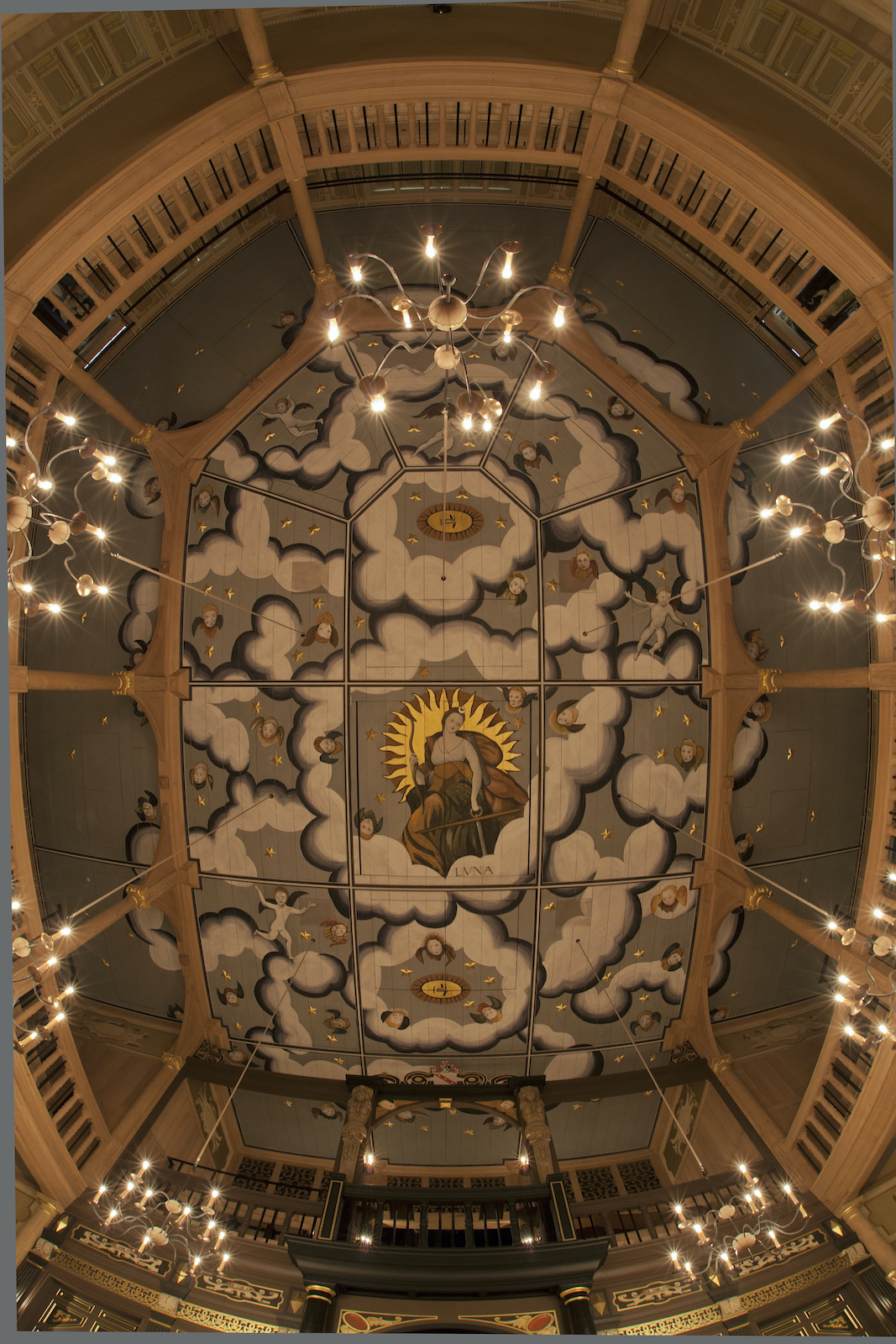 A decorated ceiling with candles