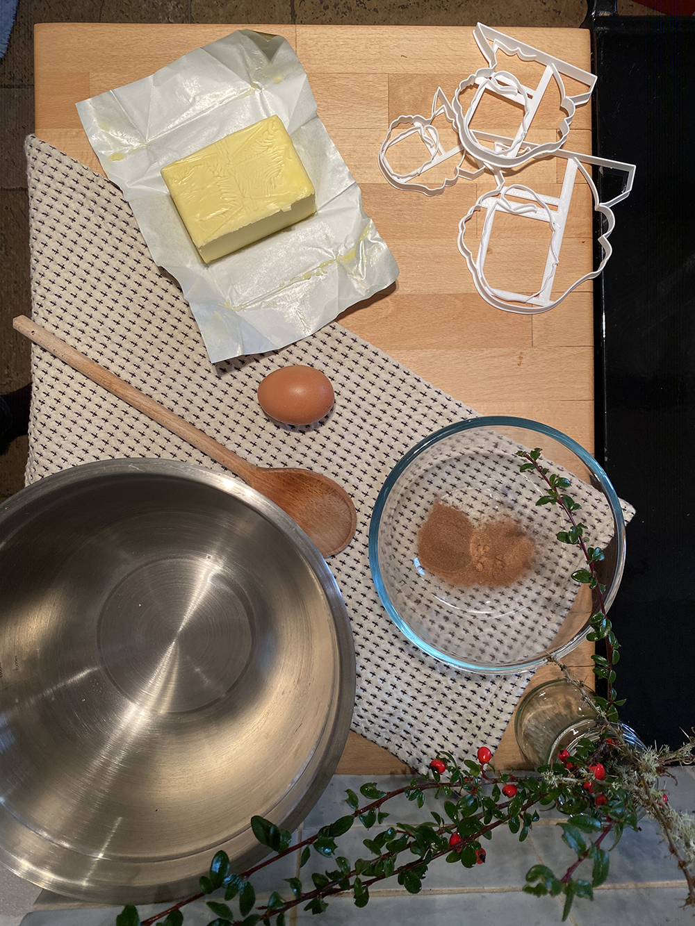 Baking ingredients, including butter, eggs, and sugar, lay on a kitchen counter,
