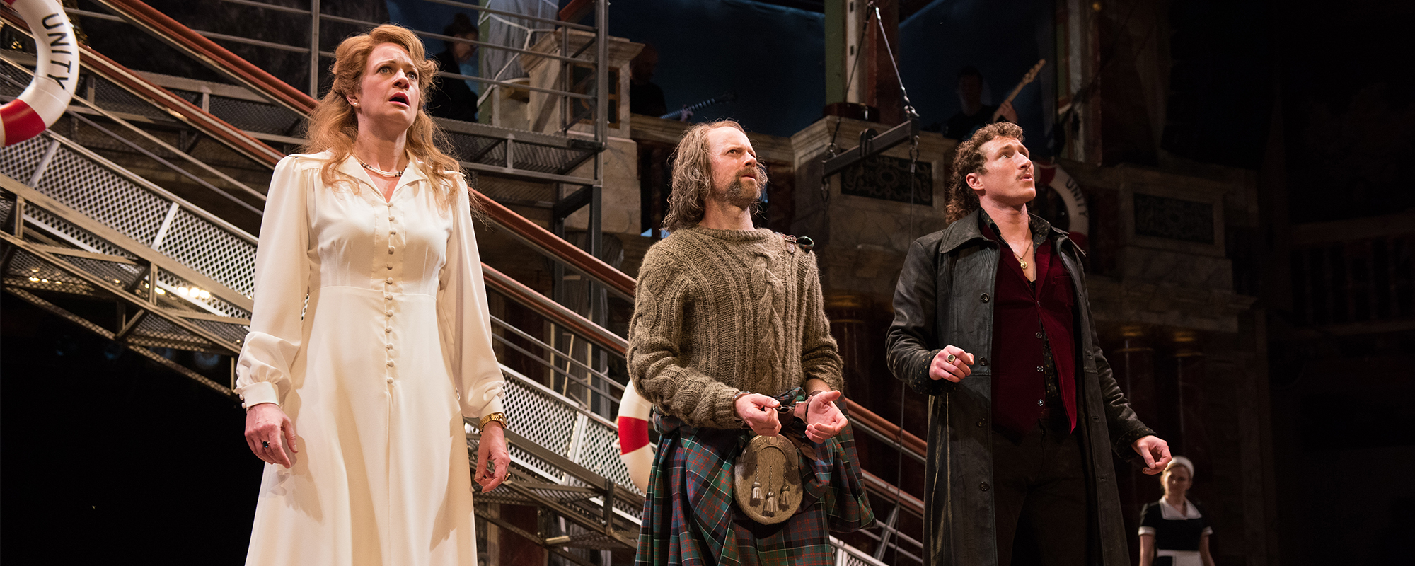 Olivia, Antonio and Orsino in Twelfth Night stand in a line in mouths open in shock
